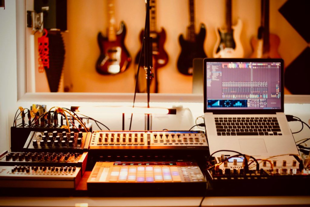 Home Recording Studio with Guitars, Laptop, Midi Controller and Mixer
