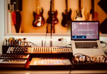 Recording Studio with Guitars, Laptop, Midi Controller and Mixer