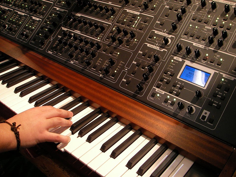 Hand playing synthesizer