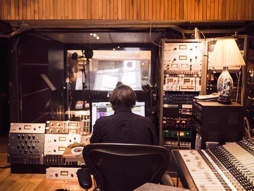 audio engineer working in recording studio