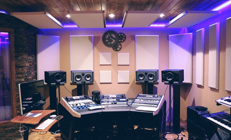 clean studio with monitors on stands