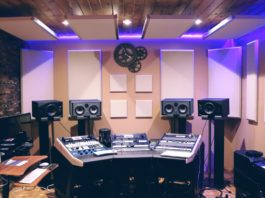 recording studio with monitors, mixing console.