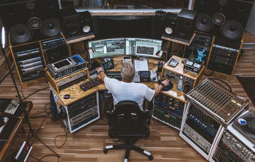Producer working at recording studio desk