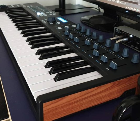 midi controller and audio interface on desk