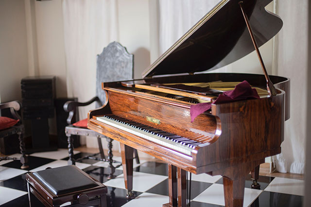 grand piano with bench and chair
